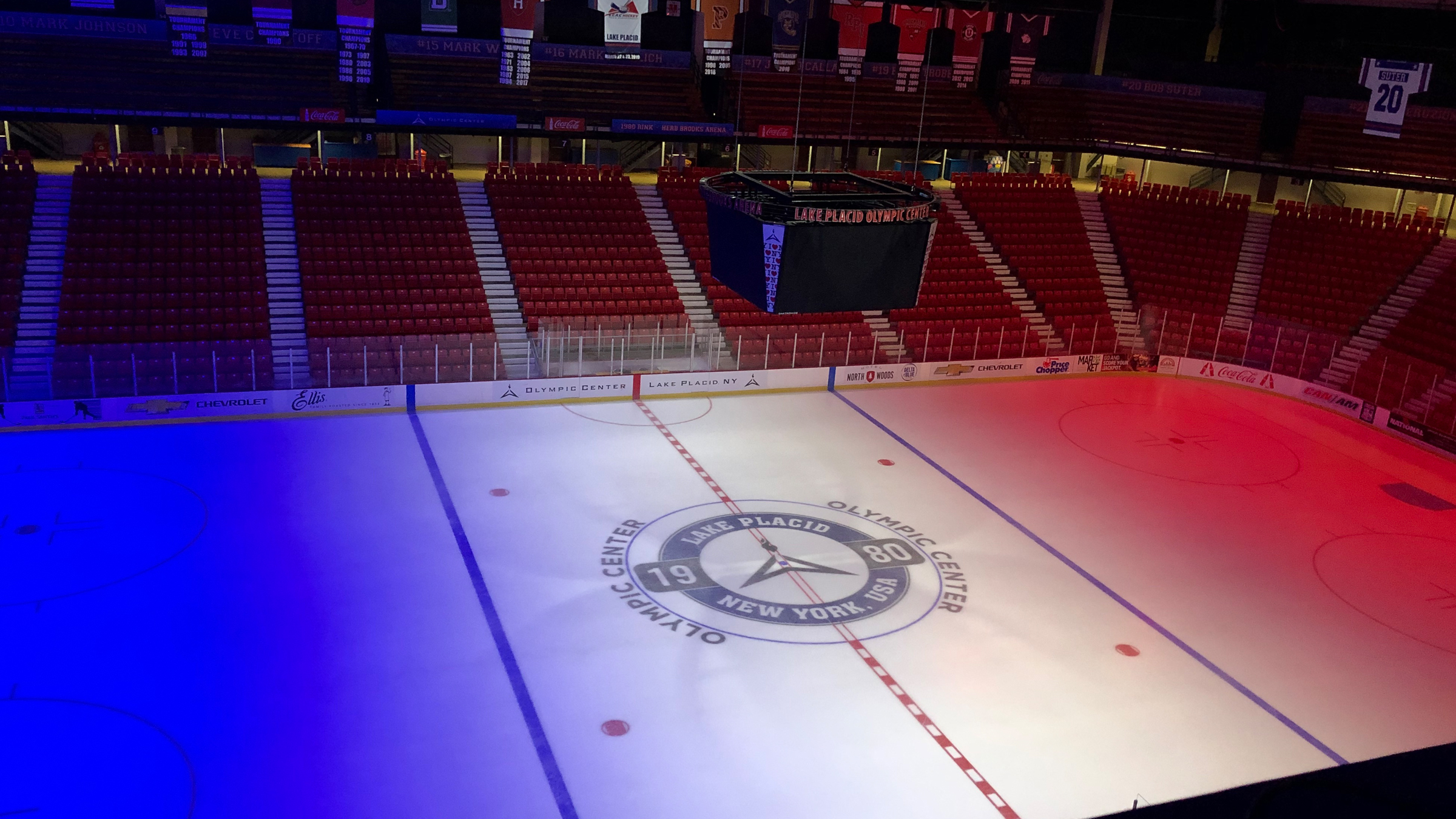 Hockey arena with colored lighting on ice