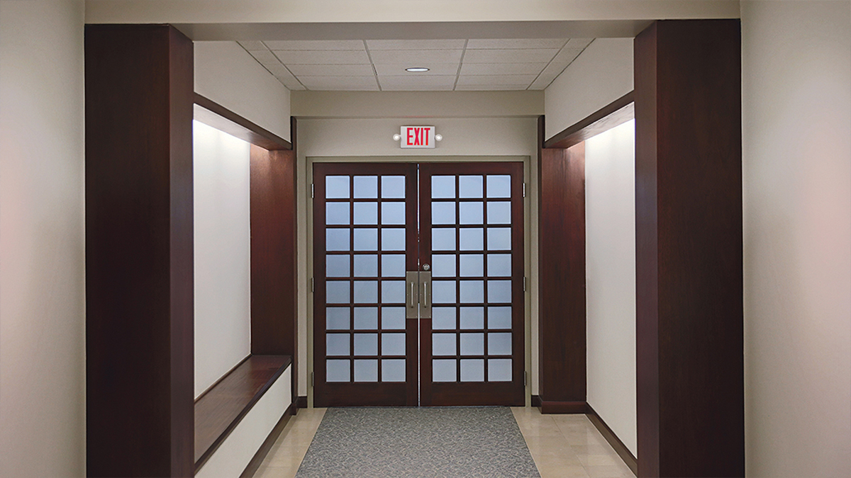 Cooper Lighting Solutions: Sure-Lite. Exit and emergency lighting can be a key factor contributing to the overall fire safety of a building. Exit signs must be illuminated at all times, even when the building is not occupied.